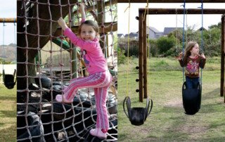 Girl climbing on a jungle gym and swinging on a swing