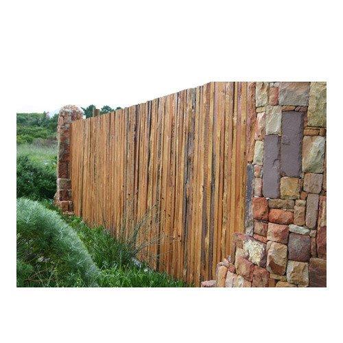 Rustic timber fence between stone pillars