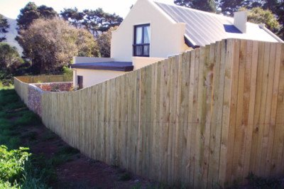 Enclosed yard with rustic timber fence