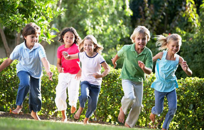Children running through a garden