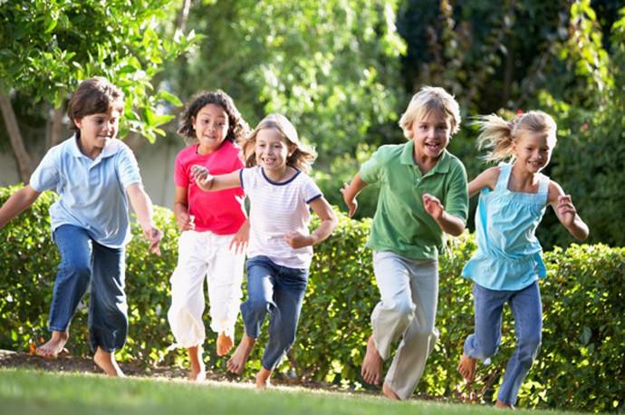 Children running through a garden