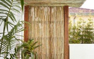 Wall of Eucalyptus, Latte, Gum Treated Poles