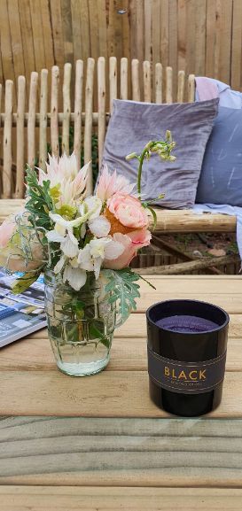 Backyard makeover wooden bench and flowers