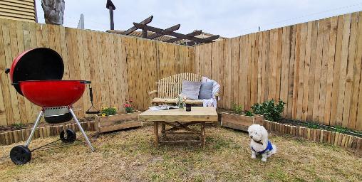 Wooden bench in backyard